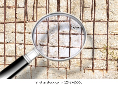 Cracked reinforced concrete wall - Concept image seen through a magnifying glass