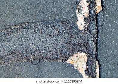 cracked rough asphalt