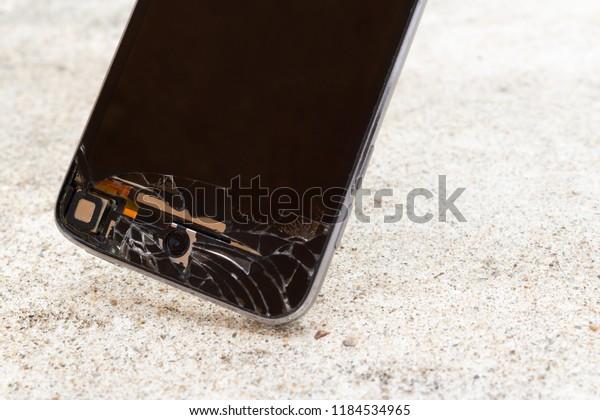 Cracked Screen Black Smart Phone Dropping Stock Photo (Edit