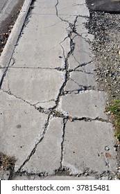 Cracked Sidewalk in Urban Area