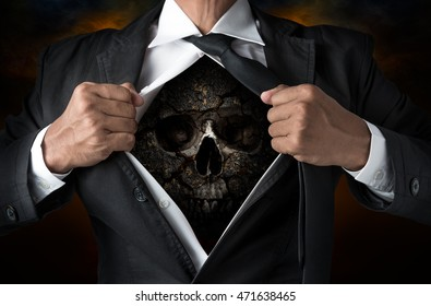 Cracked skull inside the businessman body in concept of wicked business