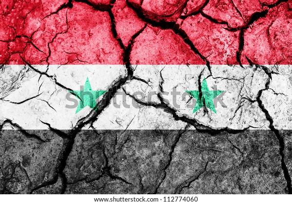 Cracked soil as Syria flag