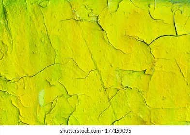 Cracked surface of old yellow wall