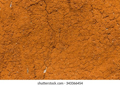 Cracked wall of cob house for background and texture. It is a natural building material made from subsoil, water and some kind of fibrous organic material.