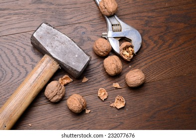 Cracked walnuts with a big hammer and an old wrench