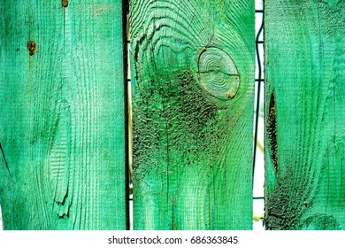 Cracked weathered green and blue painted wooden board texture. Old wooden bar with cracked paint texture. wooden planks as vintage background