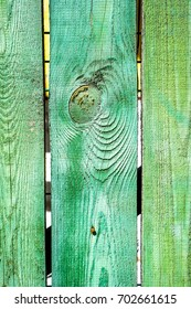 Cracked weathered green and blue painted wooden board texture. Old wooden bar with cracked paint texture