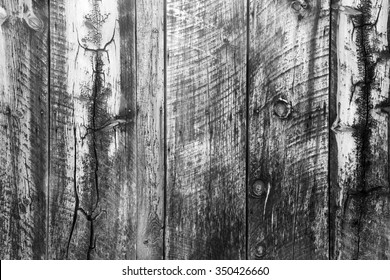 Cracked weathered wooden background in black and white.