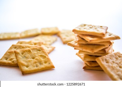 Cracker with herbs on white background