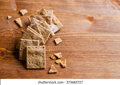 Cracker square shape with bran. Selective focus.