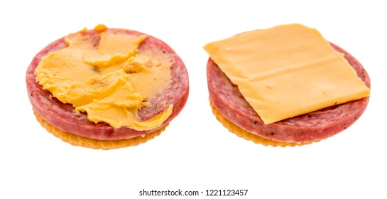 A cracker with summer sausage and cheese to make finger food , appetizer or a hors d'oeuvres depending on where your from before a meal on an isolated background