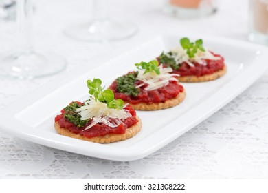 crackers with beetroot pate and pesto on plate, horizontal