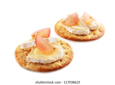 Crackers with brie cheese and grapes