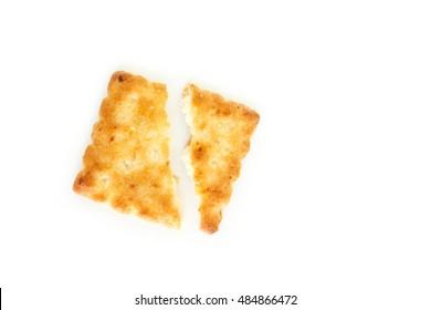 Crackers broken in half on white background.