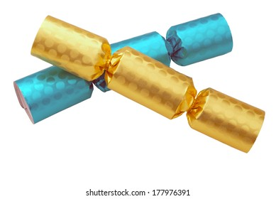 Crackers in gold and blue isolated on white