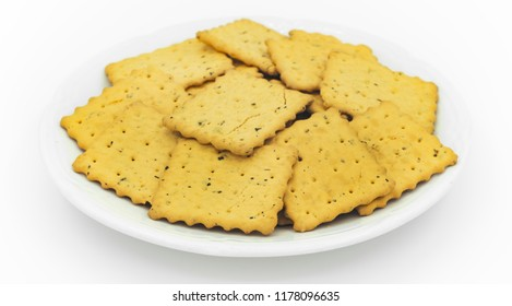 crackers in plate on white