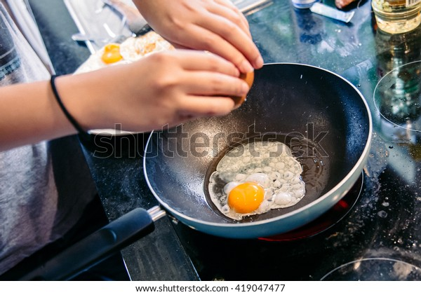 Cracking an egg into a frying pan