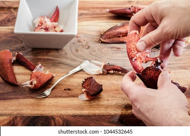 Cracking leftover lobster claws to get to the meat inside.  Getting ready to make lobster roll sandwiches