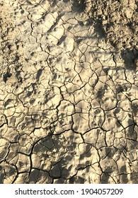 cracking of soil that is dehydrated due to drought. Susuzluktan çatlamış topraklar.  - Shutterstock ID 1904057209