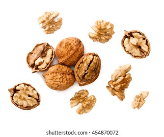 cracking walnuts on white, top view