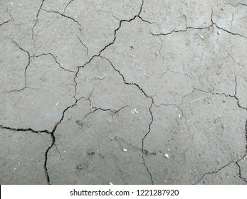 Cracks in the clay as a background top view. ( The cracked ground, Ground in drought, Soil texture and dry mud, Dry land )
