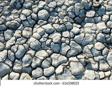 Cracks in the ground. drought. soil erosion, cracked texture. Dry cracked ground.