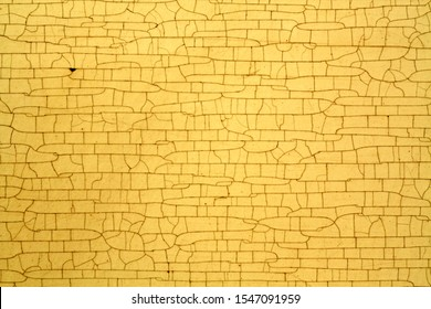 Cracks on metal yellow color texture. Abstract background and texture for design.