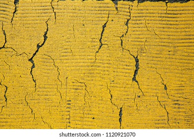 Cracks on a yellow surface