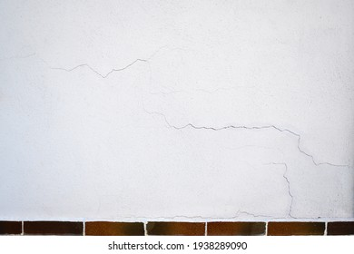 Cracks outside on the wall in plaster.