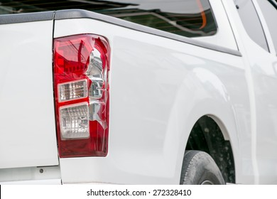 Cracks white car from being bumped the rear lights.
