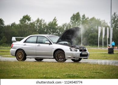 Cracov, Poland - June 24, 2018: Sport car with smoking engine, overheating engine on the road.