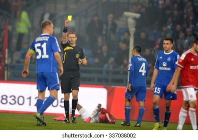 CRACOV, POLAND - OCTOBER 30, 2015: T-Mobile Extra League Polish Premier Football League Wisla Krakow - Ruch Chorzow o/p: refree yellow card Rafal Grodzicki