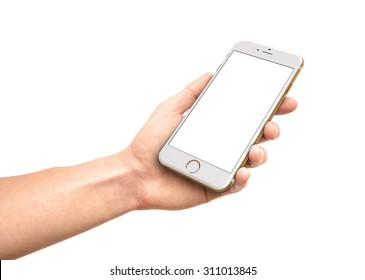 CRACOW - August 28: Man hand holding the iPhone 6 gold isolated on white background, Poland on august 28, 2015.
