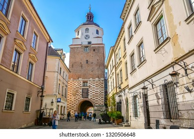 Cracow Gate in Old Town is most recognisable landmarks. Lublin is Polish city east of Vistula River near Warsaw. City Lublin, Poland: September 2018. Beautiful summer sunny day.