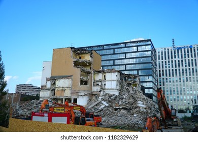 Cracow, Krakow, Poland - 15 September 2018: Office buildings demolition and crashing by machinery for new construction.