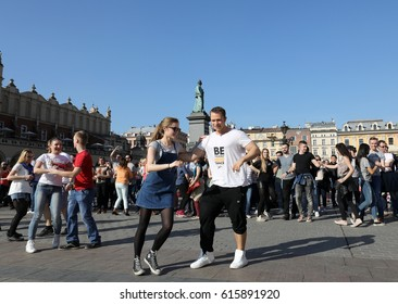 CRACOW, POLAND - APRIL 1, 2017: International Flashmob Day of Rueda de Casino, 57 countries, 160 cities. Several hundred persons dance to Hispanic rhythms on the Main Square in Cracow. Poland