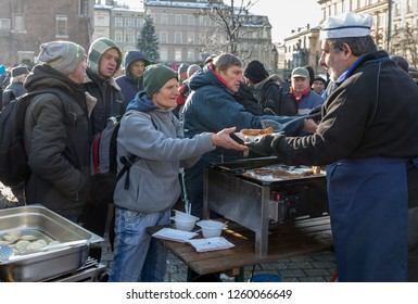 Cracow, Poland - December 16, 2018: Christmas Eve for poor and homeless on the Main Square in Cracow. Every year the group Kosciuszko prepares the greatest eve in the open air in Cracow. Poland