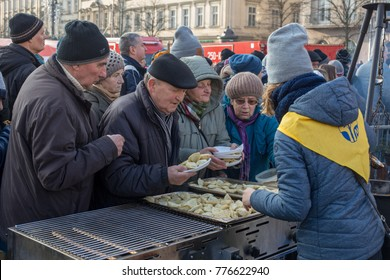Cracow, Poland - December 17, 2017:   Christmas Eve for poor and homeless on the Main Square in Cracow. Every year the group Kosciuszko prepares the greatest eve in the open air in Poland
