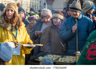 Cracow, Poland - December 17, 2017:   Christmas time meal for poor and homeless on the Main Square in Cracow. Every year the group Kosciuszko prepares a meal in the open air in Cracow. Poland