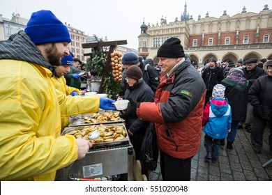 CRACOW, POLAND - DECEMBER 18, 2016:  Christmas Eve for poor and homeless on the Central Market in Cracow. Every year the group Kosciuszko prepares the greatest eve in the open air in Poland