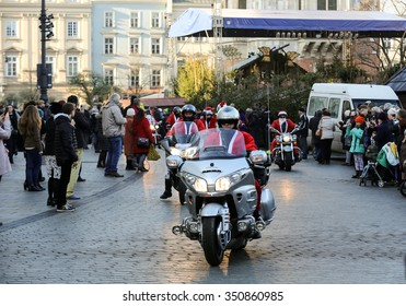 CRACOW, POLAND - DECEMBER 6, 2015: the parade of Santa Clauses on motorcycles around the Main Market Square in Cracow. Poland
