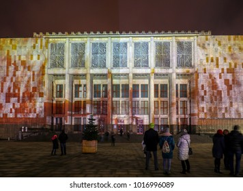 Cracow, Poland - February 3, 2018: Mapping on the facade of the National Museum inspired by the painting of Stanislaw Wyspianski. Krakow, Poland