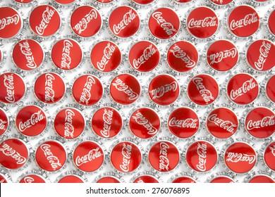CRACOW,  POLAND - JANUARY 29, 2014: CocaCola caps macro shot on white background