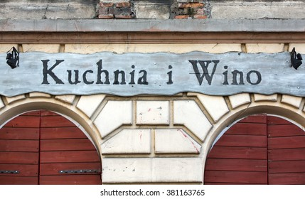 CRACOW, POLAND - JANUARY 30, 2016: vintage signboard restaurant Kuchnia i Wino in Kazimierz district in Cracow, Poland