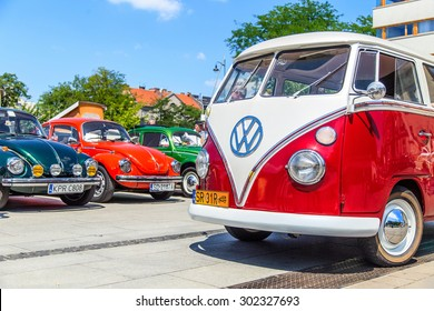 CRACOW, POLAND - July 11, 2015: Retro styled image of colorful Volkswagen Transporter type 2 vans from the seventies in Cracow, Poland
