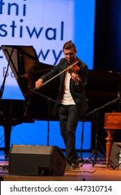 CRACOW, POLAND - JUNE 11, 2016: Adam Baldych -  Polish violinist  playing live music at Summer Jazz Festival in Cracow, Poland
