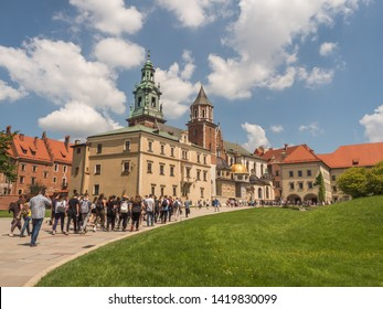 Cracow, Poland - June 2, 2019: Grroup of touists in  Wawel. View of  Royal Castle and cathedral in Cracow, Poland.  View from inside of the castle.