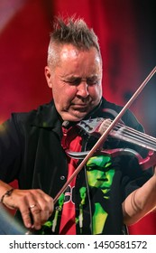Cracow, Poland - Juni 28, 2019: Nigel Kennedy and Mike Stern plays Jimi Hendrix on stage of Auditorium Maximum UJ at the Summer Jazz Festival in Krakow. Poland