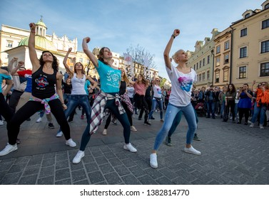 Cracow, Poland - March 30, 2019:  International Flashmob Day of Rueda de Casino. Several hundred persons dance Hispanic rhythms on the Main Square in Cracow. Poland