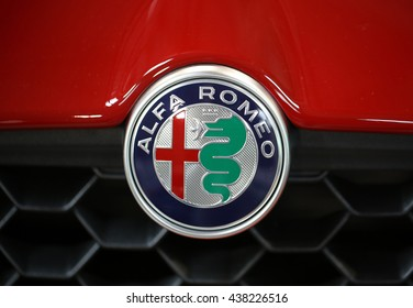 CRACOW, POLAND - MAY 21, 2016: Alfa Romeo metallic logo closeup on Alfa Romeo car displayed at 3rd edition of MOTO SHOW in Cracow